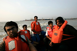 BANGLADESH MADHOM BIBIR HAT 7MARB05 - Afnan Hussain, crew and skipper, Petros Mendes & Faiz Mohammed (L-R) on a speedboat returning from the shipbreaking yards at Badhom Bibir Hat outside Chittagong, Bangladesh...jre/Photo by Jiri Rezac..© Jiri Rezac 2005..Contact: +44 (0) 7050 110 417.Mobile: +44 (0) 7801 337 683.Office: +44 (0) 20 8968 9635..Email: jiri@jirirezac.com.Web: www.jirirezac.com..© All images Jiri Rezac 2005 - All rights reserved.