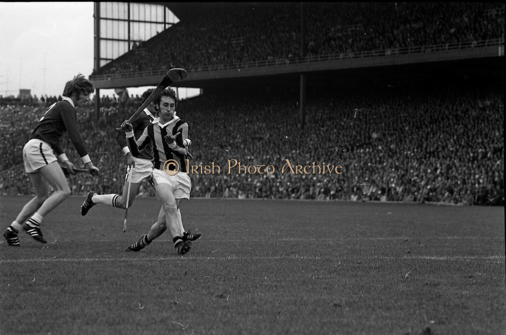 07/09/1975<br /> 09/07/1975<br /> 7 September 1975<br /> All-Ireland Hurling Final: Kilkenny v Galway at Croke Park, Dublin. <br /> Kilkenny's left center, Frank Cummins, finishes off a long solo, run with the ball on his stick, by shooting at the goal; however, the shot was saved by Galway. <br /> Niall McInerney, Galway defender, is on the left.