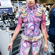 Airbrush body painting by guest artist Kate Monroe demo at IMATS London on 18 May 2019,  London, UK.
