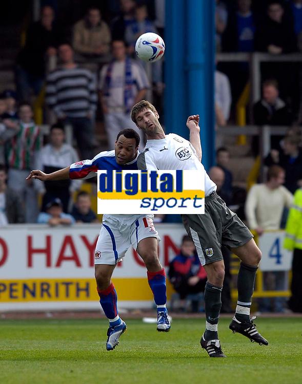 Photo: Jed Wee/Sportsbeat Images.<br /> Carlisle United v Bristol City. Coca Cola League 1. 21/04/2007.<br /> <br /> Bristol City's Jamie McCombe (R) beats Carlisle's Karl Hawley to the ball.