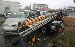 PINGTUNG, Sept. 14, 2016 (Xinhua) -- Vehicles are crushed by broken electric line poles in typhoon-hit Taiwan, southeast China, Sept. 14, 2016. Typhoon Meranti on Wednesday brought strong winds and heavy downpour to the island. (Xinhua) (ry) (Credit Image: © Johnson Liu/Xinhua via ZUMA Wire)