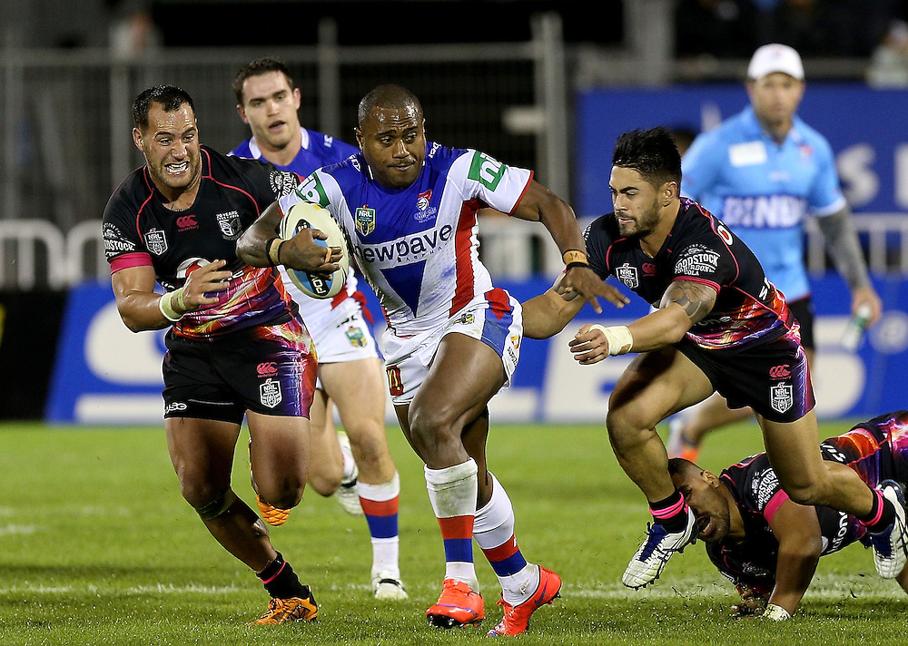 Akuila Uate of the Newcastle Knights is chased by Ben Matulino of the New Zealand Warriors, left, and Shaun Johnson of the New Zealand Warriorduring their round 12 NRL match at Mount Smart Stadium, Auckland on  Sunday, May 31, 2015. Credit: SNPA / David Rowland