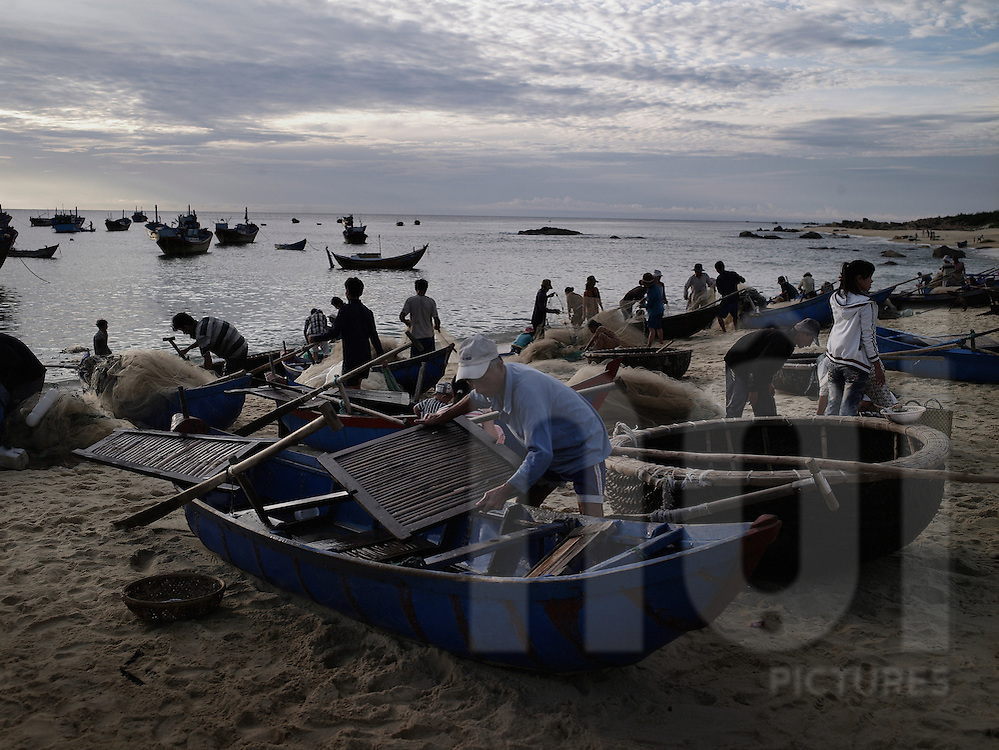 Daily fishermen's activity by early morning. Tuy Hoa, Vietnam, Asia.