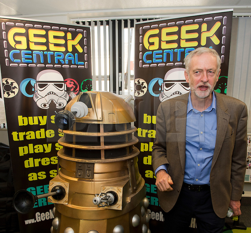 """© Licensed to London News Pictures. 26/09/2015. Brighton, UK. Leader of the Labour Party JEREMY CORBYN poses next to a darlek underneath the words """"GEEK CENTRAL"""" during a visit to Entrepreneurial Spark in Brighton, a group that promotes entrepreneuring. The visit takes place on the eve of the Labour Party conference, which is being held in Brighton Photo credit: Ben Cawthra/LNP © Licensed to London News Pictures. 26/09/2015. Brighton, UK. Leader of the Labour Party JEREMY CORBYN poses next to a dalek underneath the words """"GEEK CENTRAL"""" during a visit to Entrepreneurial Spark in Brighton, a group that promotes entrepreneuring. The visit takes place on the eve of the Labour Party conference, which is being held in Brighton Photo credit: Ben Cawthra/LNP"""