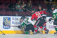KELOWNA, CANADA - DECEMBER 6: Gage Quinney #28 of Prince Albert Raiders is checked by Tyson Baillie #24 of Kelowna Rockets on December 6, 2014 at Prospera Place in Kelowna, British Columbia, Canada.  (Photo by Marissa Baecker/Shoot the Breeze)  *** Local Caption *** Gage Quinney; Tyson Baillie;