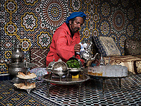 FEZ, MOROCCO - CIRCA MAY 2018:  Moroccan man in pouring traditional tea in Fez.