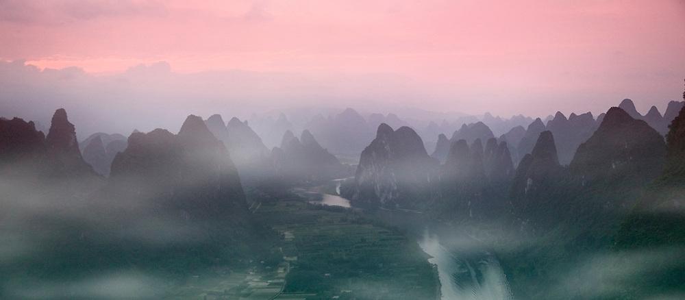 Li River winding through karst hills in early morning mist, Yangshuo, Guangxi Province, China