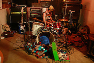 Matt Tobey, who is one half of the experimental pop band, Mt. Gigantic, sits behind the drums during a basement show.