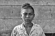 Antonia Wilson, a Miskita girl, outside her home in Billamuk, Mosquito Coast, Honduras.