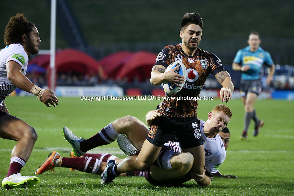 Warriors player Shaun Johnson is injured as he scores a try in the NRL Rugby League, Warriors v Sea Eagles at Mt Smart Stadium, Auckland, New Zealand. 25 July 2015. Copyright Photo: Fiona Goodall / www.photosport.nz