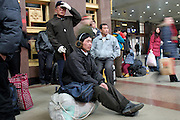 Chinese travelers wait for trains during the holiday season in the Beijing train station.