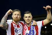 Lincoln City Midfielder Alan Power and Lincoln City Forward Jack Muldoon celebrate together punching the air during the The FA Cup fourth round match between Lincoln City and Brighton and Hove Albion at Sincil Bank, Lincoln, United Kingdom on 28 January 2017. Photo by Phil Duncan.