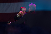 Presidential candidate Sen. Ted Cruz hugs Glenn Beck during a campaign rally on February 28, 2016 in Oklahoma City, Oklahoma.  (Cooper Neill for The New York Times)