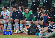 Racing 92 player DAN CARTER (R) is on the bench for the second half of the Natixis Cup rugby match between French team Racing 92 and New Zealand team Otago Highlanders at Sui San Wan Stadium in Hong Kong.