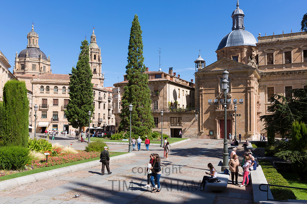 Locals stroll in Plaza de Anaya town square in Salamanca, Spain