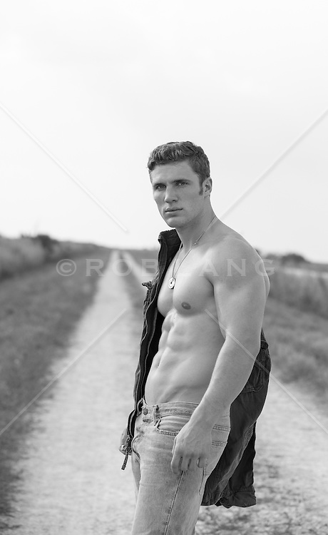 man without a shirt on a dirt road in The Everglades