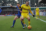 Barry Fuller (Captain) of AFC Wimbledon and Oxford United striker Jordan Bowery  during the Sky Bet League 2 match between AFC Wimbledon and Oxford United at the Cherry Red Records Stadium, Kingston, England on 27 February 2016. Photo by David Vokes.