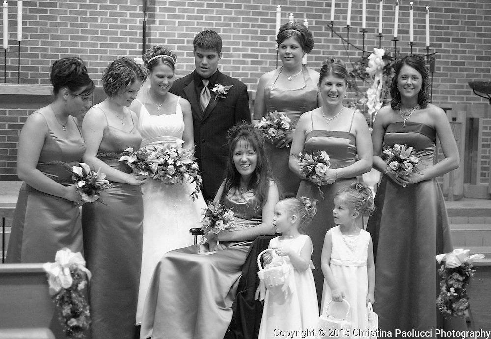 The wedding party for Jessica fate and Zak Midthum pose for pictures before the wedding in March.   (Rochester Post-Bulletin, Christina Paolucci)