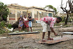 March 19, 2019 - Beira, Mozambique - Residents begin to repair damaged buildings in Beira, Mozambique, after Cyclone Idai hit the area. Large areas to the west of Beira have been severely flooded. In some areas close to the Buzi and Pungwe rivers, flood water are metres deep and have completely covered homes, telephone lines and trees.. (Credit Image: © Denis Onyodi/IFRC via ZUMA Wire)