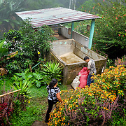 Community San Ramon, Matagalpa - Nicaragua 10-2014<br /> Photography by Aaron Sosa<br /> <br /> CECOCAFEN Project<br /> Cooperative La Hermandad.<br /> <br /> In this farm is one of the Biodigestores, harvest time when the first coffee bean washing water is taken as the ferment produces gas that is needed for use in the kitchen.