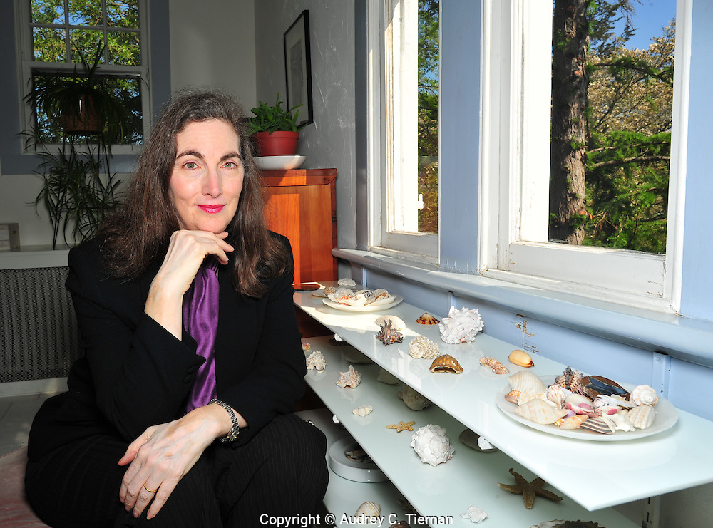Springs, NY: Saturday, May 21, 2011-- Baruch College's Distinguished Professor of Art History Gail Levin at the Pollock-Krasner House.  Levin poses Krasner's bedroom near her seashell collection. Levin has just published a biography about Lee Krasner.  © Audrey C. Tiernan