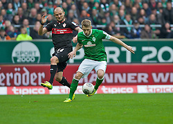 15.03.2014, Weserstadion, Bremen, GER, 1. FBL, SV Werder Bremen vs VfB Stuttgart, 25. Runde, im Bild Konstantin Rausch (VfB Stuttgart #34) verteidigt gegen Aaron Hunt (Bremen #14) // Konstantin Rausch (VfB Stuttgart #34) verteidigt gegen Aaron Hunt (Bremen #14) during the German Bundesliga 25th round match between SV Werder Bremen and VfB Stuttgart at the Weserstadion in Bremen, Germany on 2014/03/16. EXPA Pictures © 2014, PhotoCredit: EXPA/ Andreas Gumz<br /> <br /> *****ATTENTION - OUT of GER*****