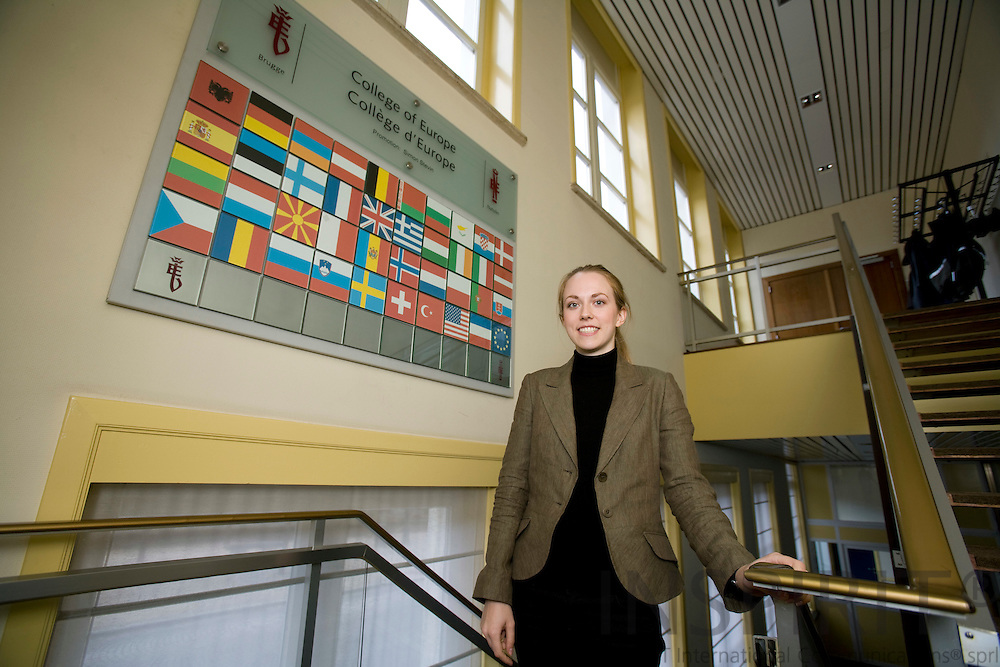 BRUGES - BELGIUM - 09 NOVEMBER 2007 --  College of Europe/Collège d'Europe -- Lina NORDBORG, Swedish student at the college at a big sign with logo and flags showing the countries where the students in coming from.  Photo: Erik Luntang/