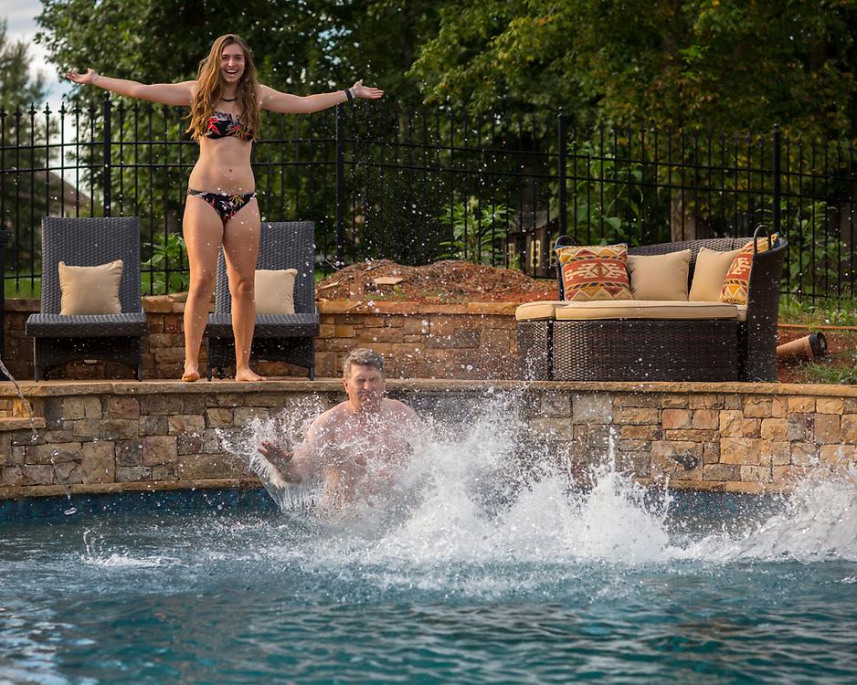 The Warner family tries the new pool, Monday, July 31, 2017 inCumming, Georgia. (Photo/Stephen B. Morton)