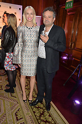 "AMANDA CRONIN and MARK HIX at the presentation of Le Prix Champagne De La Joie de Vivre to Stephen Webster in celebration of his long standing contribution to ""Joie de Vivre' held at the Council Room, One Great George Street, London on 22nd April 2015."