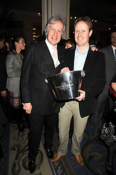 Left to right, KIT CHPMAN and his son DOMINIC CHAPMAN winner of the best young chef award at the 2009 Tatler Restaurant Awards in association with Champagne Louis Roederer held at the Mandarin Oriental Hyde Park, 66 Knightsbridge, London SW1 on 19th January 2009.