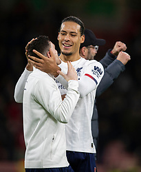 BOURNEMOUTH, ENGLAND - Saturday, December 7, 2019: Liverpool's Virgil van Dijk (R) celebrates with team-mate Andy Robertson after the FA Premier League match between AFC Bournemouth and Liverpool FC at the Vitality Stadium. Liverpool won 3-0. (Pic by David Rawcliffe/Propaganda)