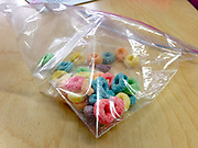 Bag of Fruit Loops snack on students desk