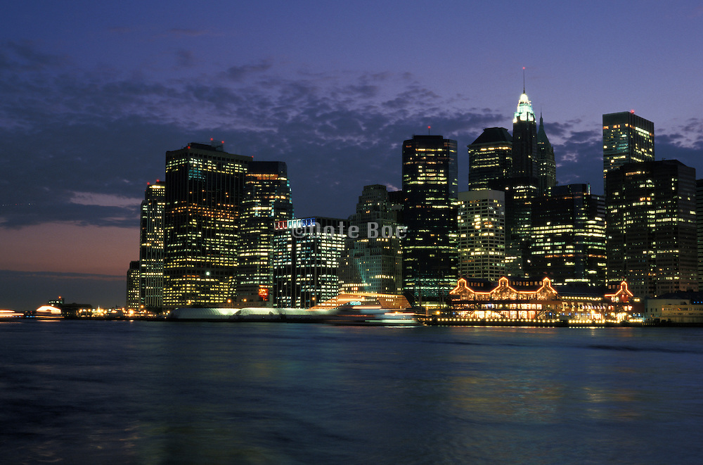 View of downtown NYC at night from across the East River