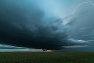 I chased this cyclic supercell from eastern Montana into South Dakota. In total, it produced 8 tornadoes. This was taken just before it dropped the last tornado of the day after sunset.