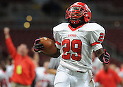 Eric Phillips, Kirkwood, celebrates as he returns an interception for a touchdownl in the Pioneers 31-7 win over Fort Osage in the Class 5 championship game at the Edward Jones Dome in St. Louis, MO., on Friday, Nov. 23, 2012. Andrew Jansen, STLhighschoolsports.com