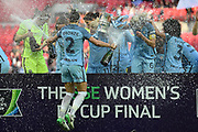 Manchester City Women's defender Lucy Bronze (2) sprays champagne in celebration on her team mates after the SSE Women's FA Cup Final match between BIrmingham City Ladies FC and Manchester City Women at Wembley Stadium, London, United Kingdom on 13 May 2017. Photo by Martin Cole.