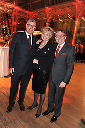 Left to right, TERRY MILLS of Comic Relief, ANGELA RIPPON and MICHAEL MacMILLAN Group President of TJX Europe at One Night Changes Everything - a fundraising evening for the 2013 Comic Relief Campaign held at The Royal Opera House, London on 28th February 2013.