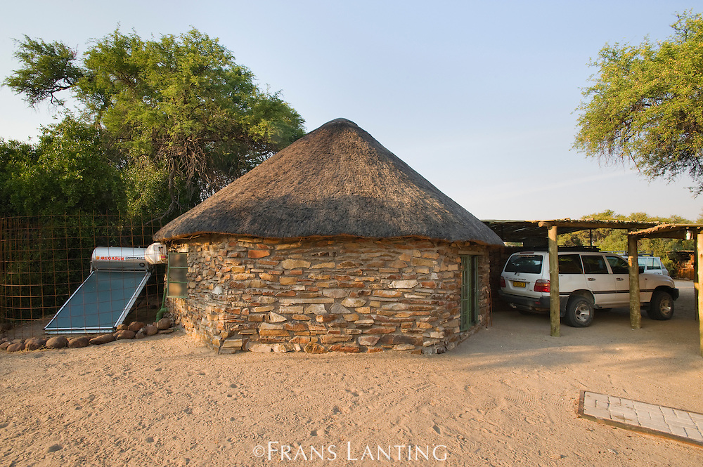 Solar panel and buildings constructed of local materials, Puros Bush Lodge, Puros Conservancy, Damaraland, Namibia
