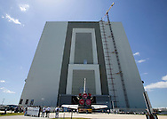 CAPE CANAVERAL, FL - MAY 12:  Space Shuttle Discoverey is rolled from the Orbiter Processing Facility 3 into the Vehicle Assembly Building at the Kennedy Space Center, Florida, May 12, 2006. The shuttle is expected to fly no earlier than July.(Photo by Matt Stroshane/Getty Images)