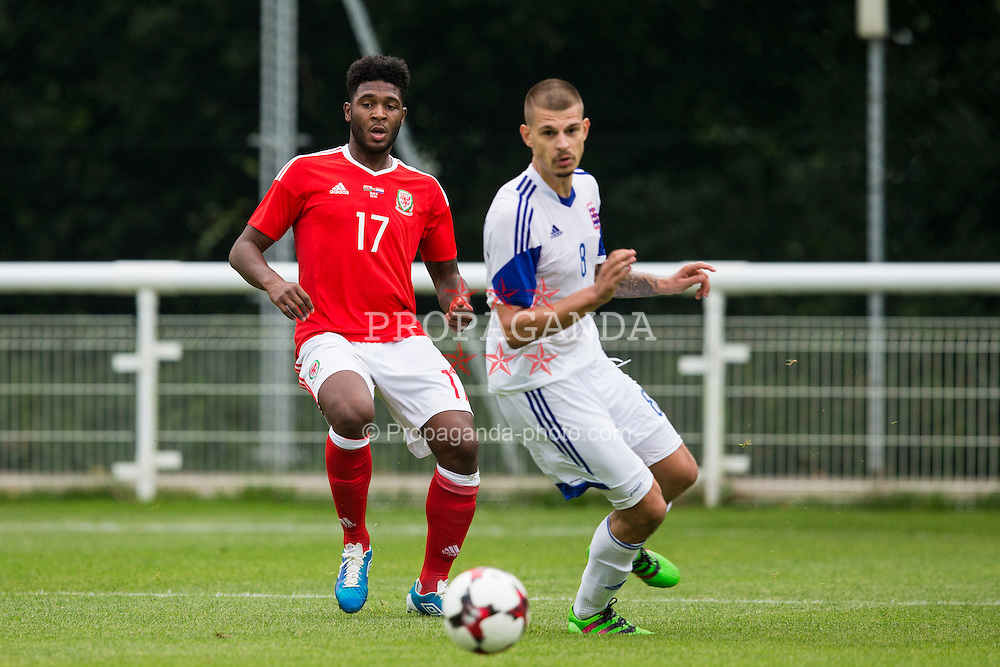 BANGOR, WALES - Tuesday, September 6, 2016: Wales' Ellis Harrison in action against Luxembourg's Nenad Dragovic during the UEFA Under-21 Championship Qualifying Group 5 match at Nantporth Stadium. (Pic by Paul Greenwood/Propaganda)