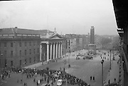 The top of Nelson's Pillar in O'Connell Street was destroyed by a bomb in the early hours of the morning. The area around the remains is cordened off by police while workmen clear the rubble. On the left is the G.P.O. where the Irish Republic was proclaimed in 1916..08.03.1966