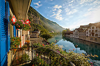 Scenic view from the Hotel Aarburg of the Aare river and alps in Interlaken, Switzerland.