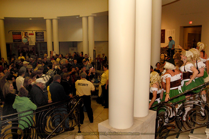 The Rubi Girls (right) pose for pictures in the lobby of the DAI during a rain delay of the Preview Party for the 41st annual Oktoberfest at the Dayton Art Institute, Friday, September 21, 2012.