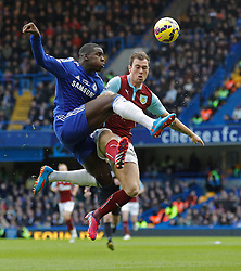 Chelsea's Kurt Zouma and Burnley's Michael Keane compete for the ball - Photo mandatory by-line: Mitchell Gunn/JMP - Mobile: 07966 386802 - 21/02/2015 - SPORT - Football - London - Stamford Bridge - Chelsea v Burnley - Barclays Premier League