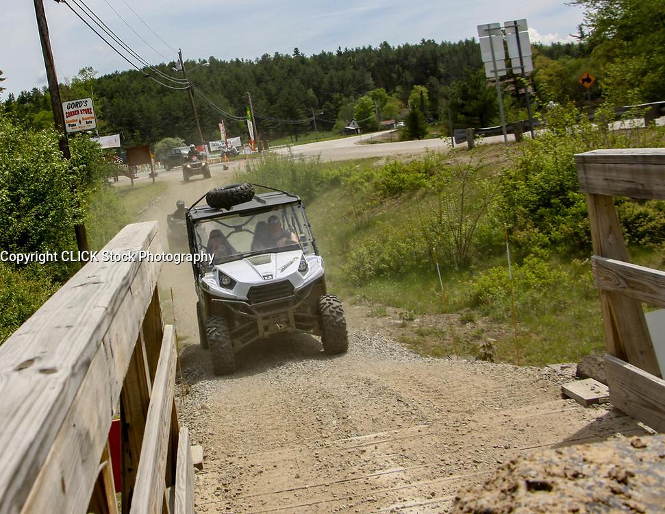 Kawasaki Teryx crossing bridge with Gord's Store sign behind them, Gord's, Kawasaki, Teryx, bridge, NH, New Hampshire, New England, atv, utv, sxs, ohrv, orv, trail riding, hobby, adventure, sports, therapy, Click Stock Photography