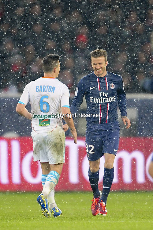 24.02.2013 Paris, France. David Beckham and Joe Barton during the French Ligue 1 game between PSG and Marseille from the Parc des Princes.