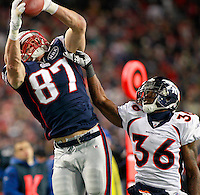 New England Patriots tight end Rob Gronkowski (87) pulls in a 28-yard reception in front of Denver Broncos safety Rafael Bush (36) in the fourth quarter of the AFC divisional playoff game at Gillette Stadium in Foxboro, Massachusetts on January 14, 2012.  The Patriots defeated the Broncos 45-10.  UPI/Matthew Healey