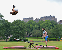 Pictured: Rauli Dahlberg (left) and Jarno Polhuijs practice their skills with Edinburgh Castle as a backdrop.<br /> <br /> Finnish circus stars Race Horse Company limber up for this years Edinburgh Festival Fringe in the Meadows.<br /> <br /> © Dave Johnston / EEm