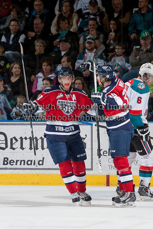 KELOWNA, CANADA - MARCH 23: Philip Tot #17 of the Tri-City Americans celebrates a goal against the Kelowna Rockets on March 23, 2014 during game 2 of the first round of WHL Playoffs at Prospera Place in Kelowna, British Columbia, Canada.   (Photo by Marissa Baecker/Getty Images)  *** Local Caption *** Philip Tot;