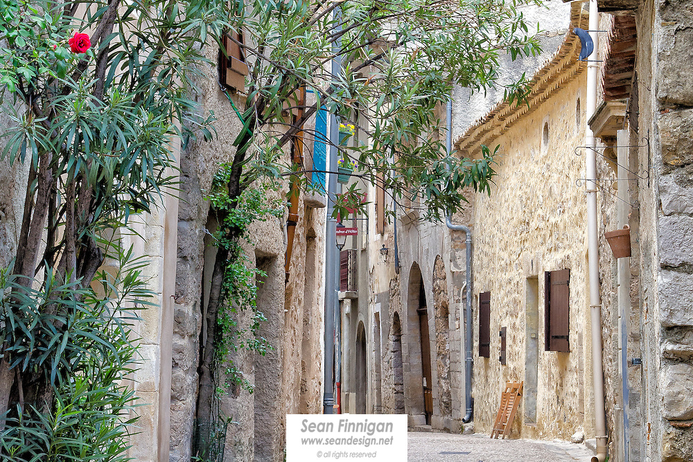A quiet street of Saint-Guilhem-le-Désert, a stopping place on the pilgrimage route to Santiago de Compostela – attracting thousands of pilgrims and tourists alike. Its church is a gem of Romanesque art of the Languedoc region of the South of France.